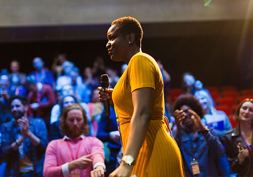 A woman speaks to a crowd