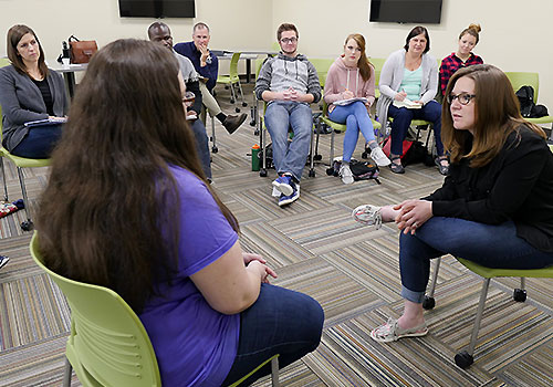 Students practice counseling in a Masters class