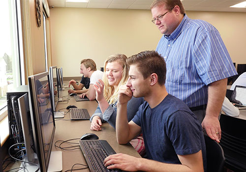 Students and faculty interact in the Communications Lab