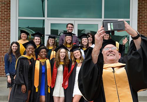 Graduates pose for a group photo