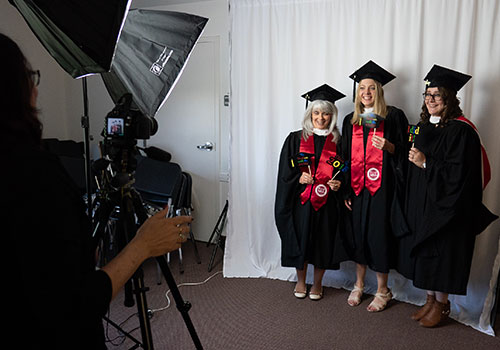 Graduates from LBC Capital get their photo taken