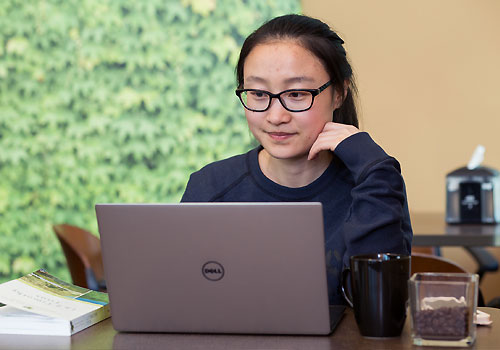 An international student fills out an online application