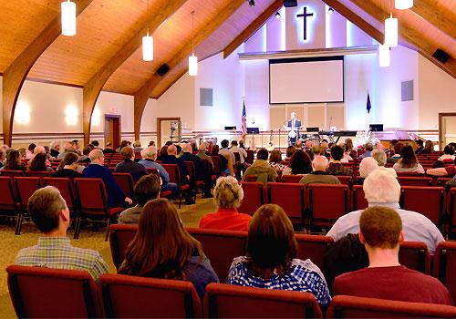 A pastor preaches to his congregation