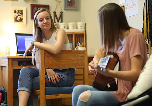 Students enjoy a Peterson dorm room