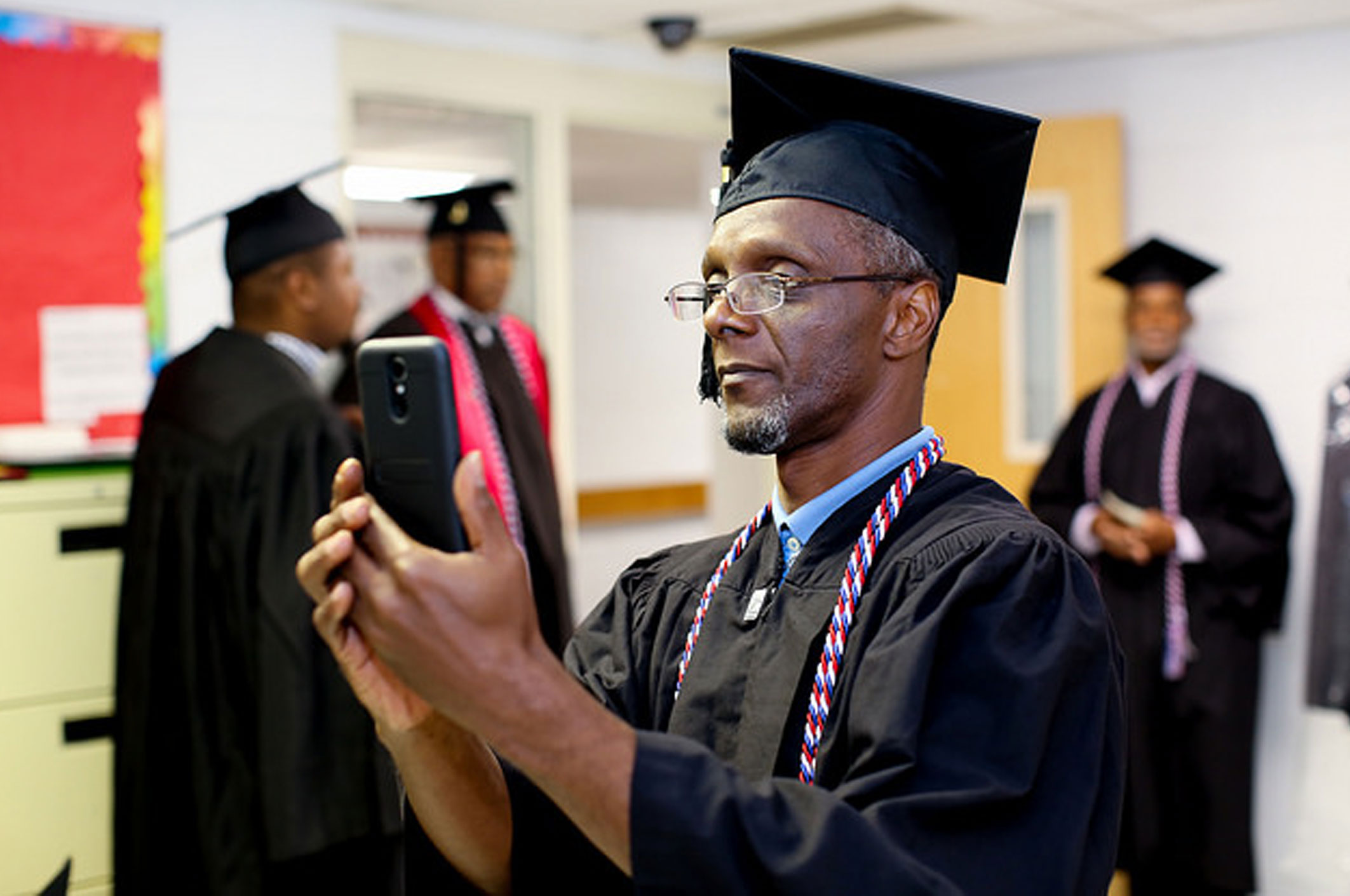A graduate takes a selfie before the ceremony