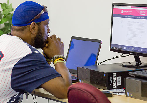 A student uses one of the computers in the Philadelphia library