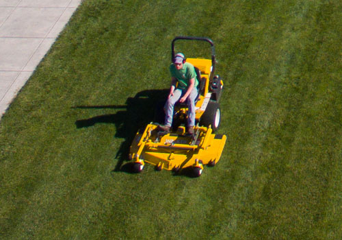 A student mowing the lawn at LBC