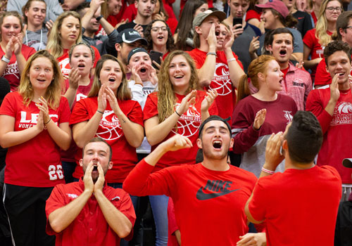 Students cheer at a Chargers Basketball Game