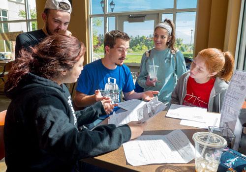 Students interact between classes in Benee's Cafe